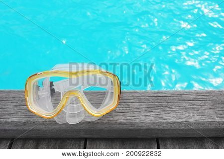 Mask for snorkeling on wooden pontoon at sea resort. Summer vacation concept