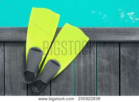 Flippers on wooden pontoon at sea resort. Summer vacation concept