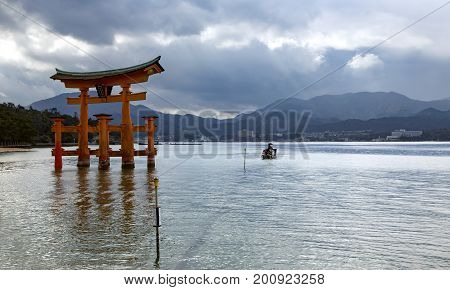 Miyajima island, the famous Itsukushima Floating Torii gate, Japan. The great Torii is the boundary between the spirit and the human worlds.