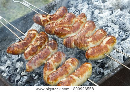 grilled sausage on a barbecue grill macro