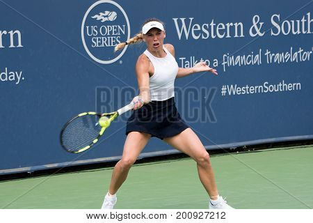 Mason Ohio - August 16 2017: Caroline Wozniaki in a second round match at the Western and Southern Open tennis tournament in Mason Ohio on August 16 2017.