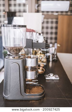 Coffee grinder in the cafe on the bar counter vertical frame