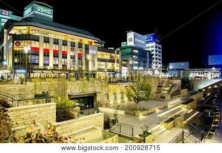 JAPAN, HIMEJI, APRIL, 02, 2017 - Night scene of streets with modern multi-storey buildings in Himeji, located in Hyogo Prefecture in the Kansai region of Japan.