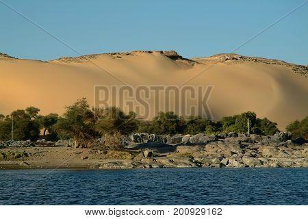 Huge velvet sand dune on the island of Elephantine without people, Blue Nile. Aswan, Egypt, North Africa, Africa