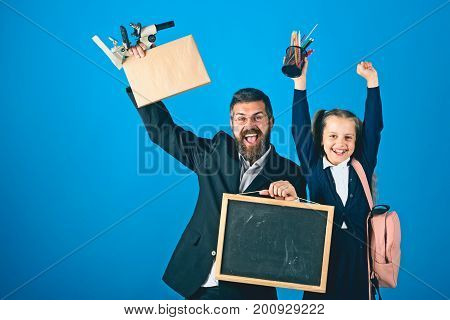 Father And Schoolgirl With Happy Faces On Blue Background