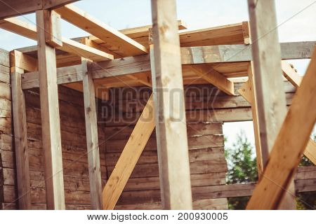 Unfinished ecological wooden house and building area