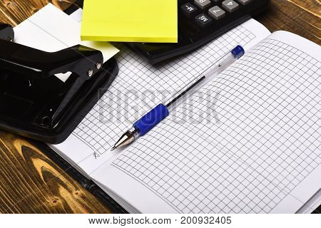 Open Notebook With Stationery On Top, Close Up