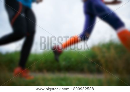 Defocused image of two sportswomen