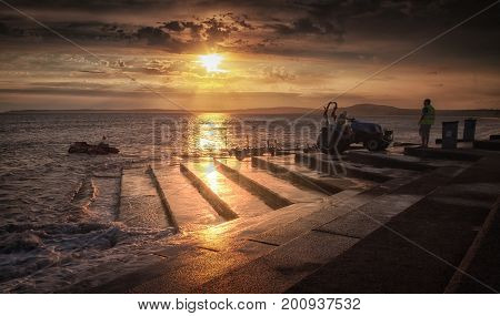 Editorial Port Talbot, UK - August 23, 2017: The Royal National Lifeboat Institution, a charity that saves lives at sea, launch a training lifeboat off Aberavon beach at high tide