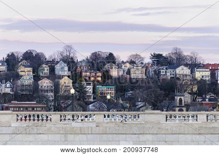 Providence Rhode Island USA - March 1 2008: View across Rhode Island State House toward Smith Hill residential neighborhood at dusk in Providence Rhode Island