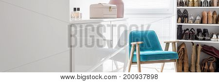 Pink Box And Perfumes On Glossy Commode