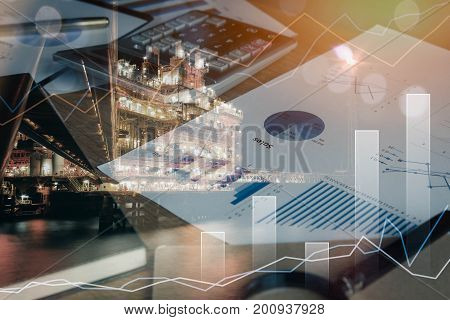 Double exposure calculator and document charted on office desk and offshore oil and gas platform night time at sea.