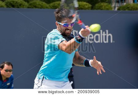 Mason Ohio - August 16 2017: Janko Tipsaveric in a second round match at the Western and Southern Open tennis tournament in Mason Ohio on August 16 2017.