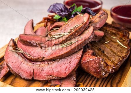 Sliced Appetizing Grilled Tongue, Decorated With Herbs. Horizontal Frame