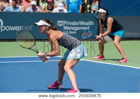 Mason Ohio - August 17 2017: Martina Hingis and Yung-Jan Chan play in a doubles match at the Western and Southern Open tennis tournament in Mason Ohio on August 17 2017.