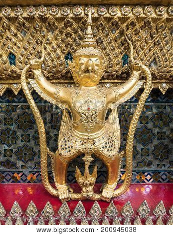 Fairytale animal statue looks like a Garuda which decorated around the Thai church in the grand palace Bangkok Thailand.