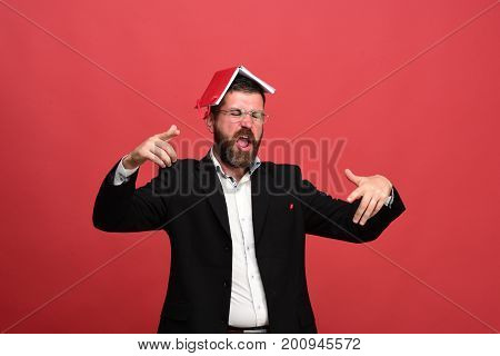 Businessman With Hooligan Face And Glasses On Light Red Background