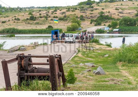 Ukraine Southern Bug River - 18 June 2017: Ferry crossing. A device for setting and fixing a steel cable for a river ferry. Such a ferry is unique in Ukraine.
