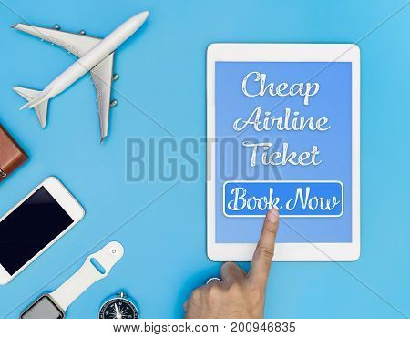 Travel Cheap Airline ticket click button on tablet