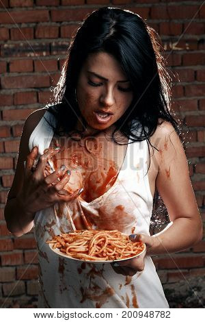Sexy Seductive Cheeky Girl In White T-shirt And Plate Of Pasta With Ketchup, Her Hands And Eats And