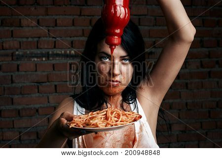 Sexy Seductive Cheeky Girl In A White T-shirt And A Plate Of Pasta With Ketchup, Smeared With Ketchu