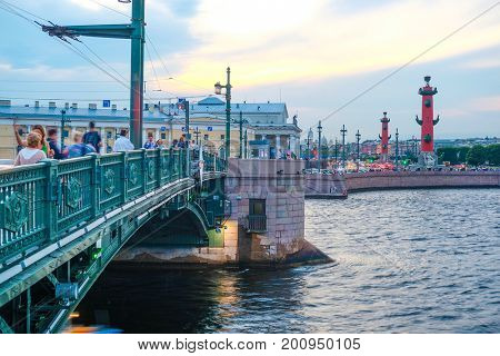 Sankt-Peterburg, Russia - August, 19, 2017: Neva embankment with Rostral Columns and Dvorcoviy bridge in Sankt-peterburg