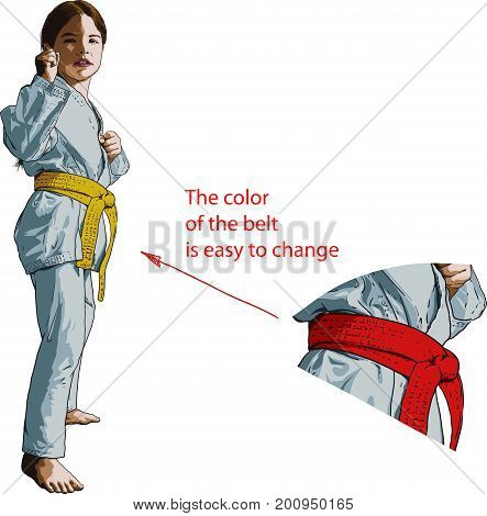 Little girl karateka stands in a fighting position facing the viewer.