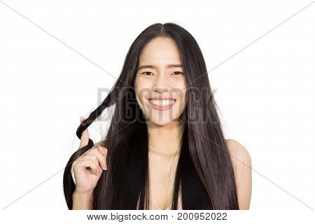Beautiful young asian woman healthy long hair look at her hair and holding her hair , Beauty model woman , Hair style and Fashion Concept , isolated on white background
