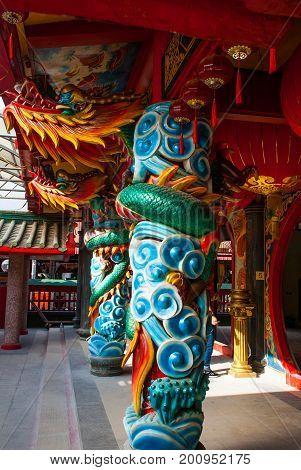 Multi-colored Dragon On The Pole. Chinese Temple Tua Pek Kong. Miri City, Borneo, Sarawak, Malaysia