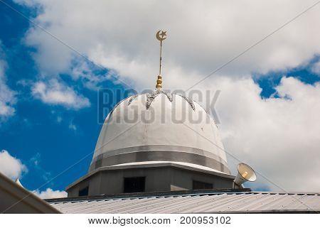 The Dome Of The Main Mosque On The Blue Sky Background. Miri City, Borneo, Sarawak, Malaysia