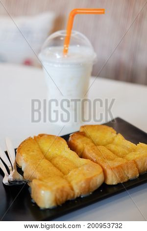 Toast bread served with ice milk (toast butter with sweetened condensed milk)