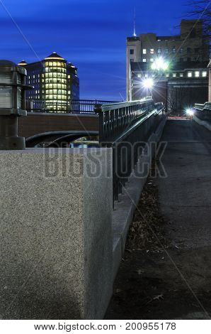Providence lighting up at dusk along river