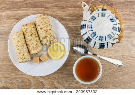 Pancakes With Stuffed, Lemon, Sugar, Teapot, Teaspoon  And Tea