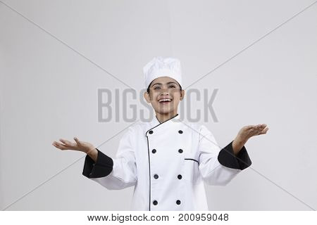 Chef with white uniform juggling with something
