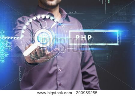 Business Technology Internet and network concept. Young businessman working on a virtual screen of the future and sees the inscription: PHP