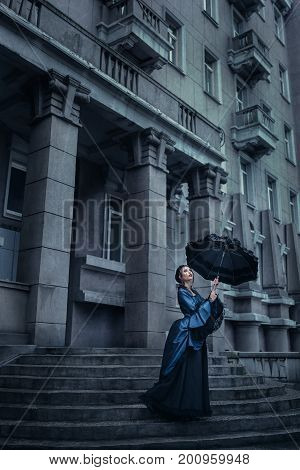 Outdoors portrait of a victorian lady in blue
