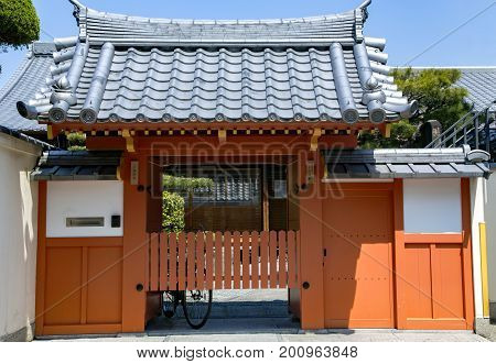 Traditional  Japanese architecture small houses with roof tile ornamentation with floral and plant designs in Kyoto, Japan.