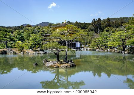 JAPAN, TOKYO, APRIL, 06, 2017 - Kinkaku-ji Temple or Golden Pavilion, officially named Rokuon-ji  is one of Japan`s most famous temples. World Heritage listed, and it is truly unique.Kyoto. Japan.