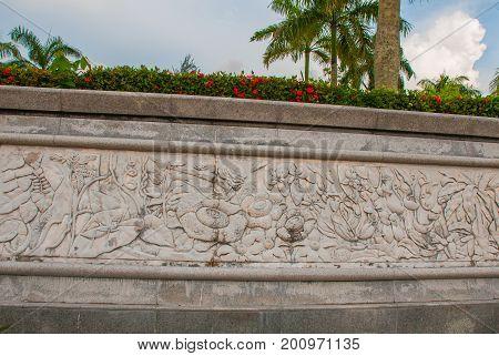 The Frieze Decorated With Plant And Flower Rafflesia. Miri City Fan Park, Borneo, Sarawak, Malaysia