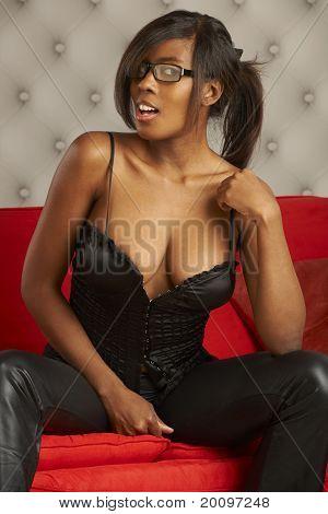 Flirting Model On Red Sofa