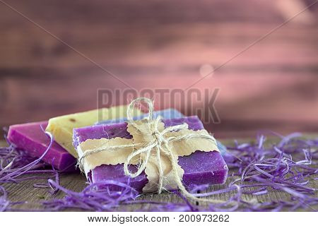 Collection of handmade, natural organic soap on wooden background. Spa products.