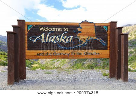 Welcome to Alaska state border highway road sign