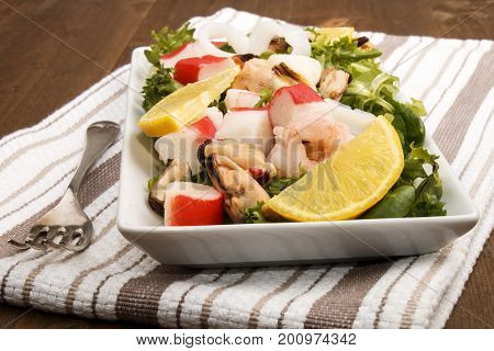 seafood salat on a white plate and fork