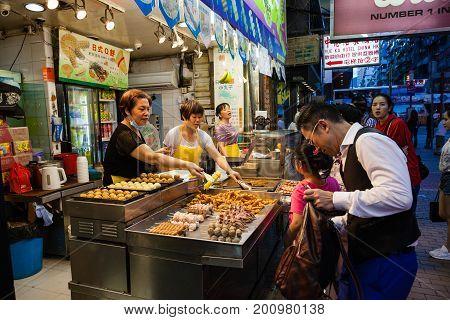 Hong Kong Street Food Vendor At Night Market