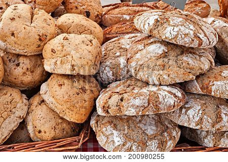 Italian rye bread from Trentino-Alto Adige, loaves with walnuts and traditional Ur-Paarl with fennel seeds