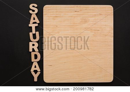 Word Saturday with blank wooden board. Timetable, day of week, to-do-list, time management concept
