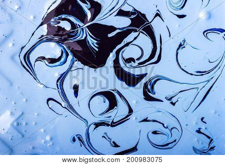 Abstract background. Paints. Fantastic patterns obtained by mixing blue paint white