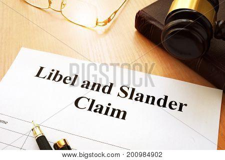 Libel and Slander Claims on a desk.