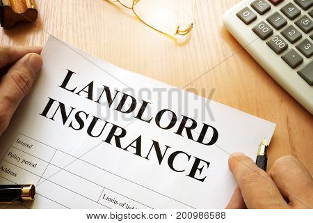 Landlord insurance and calculator on a desk.
