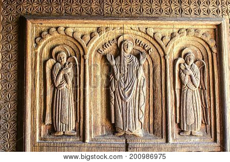 Carved angels and St. Hripsime on a wooden door in the Church of the Martyr St. Hripsime in Echmiadzin